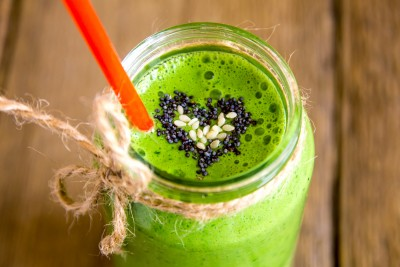 Green vegetable and herbs smoothie with heart of poppy and sesame seeds. Love for a healthy raw food concept.